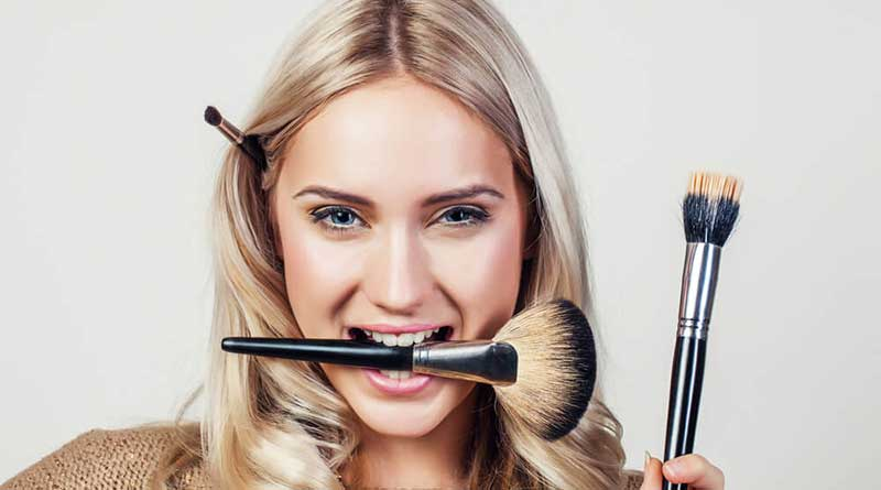 Why is it necessary to wash your makeup brushes often?